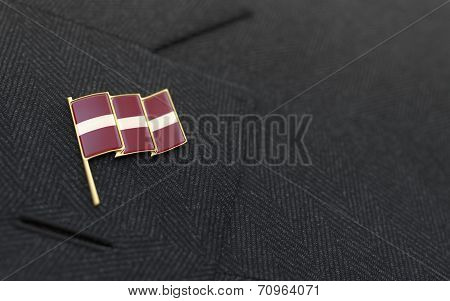 Latvia Flag Lapel Pin On The Collar Of A Business Suit