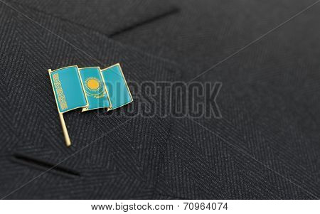 Kazakhstan Flag Lapel Pin On The Collar Of A Business Suit