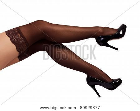 Sexy woman legs wearing pantyhose and black high heels isolated on white background poster