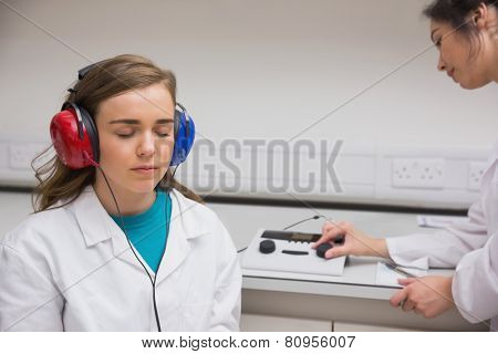 Student doing a hearing test at the university