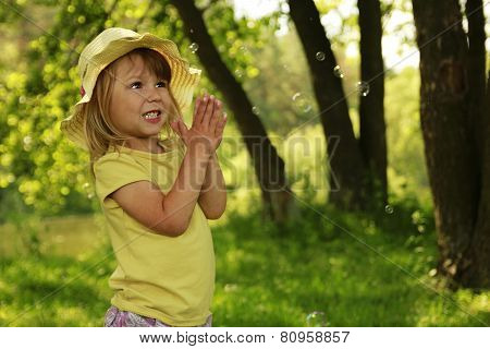 a very nice  little girl with soap bubbles
