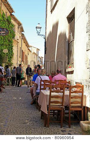 Outdoor Cafe On Beautiful Medieval Street In Saint Paul De Vence