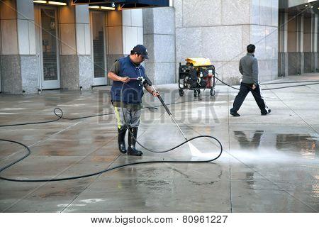 Man Using Pressure Washer