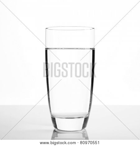 Glass of water on light background