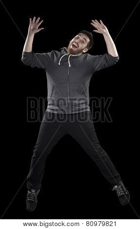 Happy Man in Wacky Pose on Black Background
