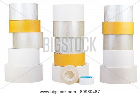 Set Of Stacks Of Adhesive Tape Rolls Isolated On White