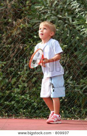 boy watching tennis ball