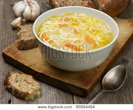 noodle soup in a cup on a wooden background poster