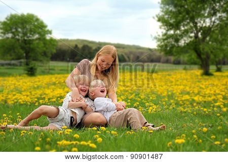 Mother Tickling Young Children