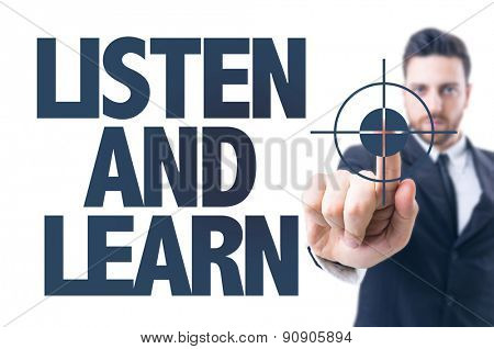 Business man pointing the text: Listen and Learn