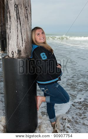 Happy teen in caught by wave