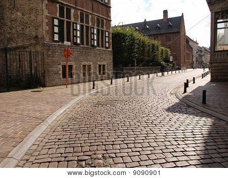 Sunlit cobblestone street in Europe