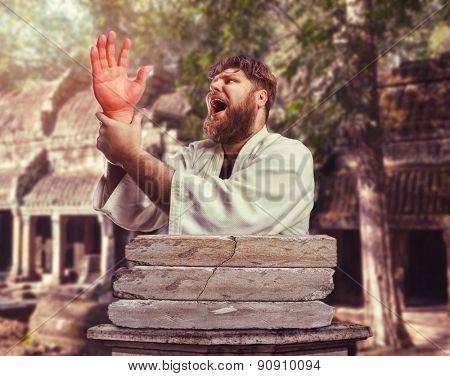 Strong karateka with an injured hand