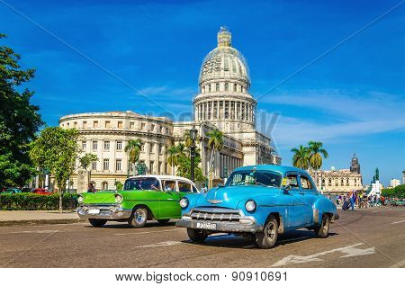 HAVANA, CUBA - DECEMBER 2, 2013: Old classic American cars rides in front of the Capitol. Before a n