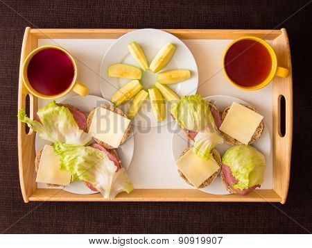 Homemade Breakfast: Bread With Cheese, Ham And Letuce, With Apple And Tea, Prepared For A Couple