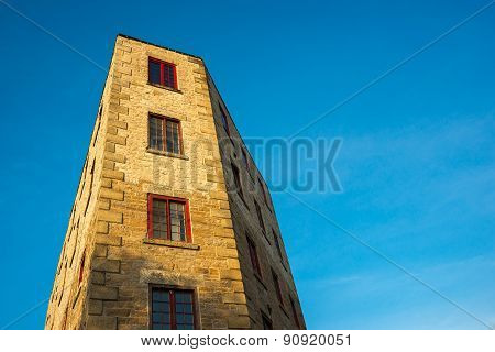 Oddly Shaped Building Against Blue Sky