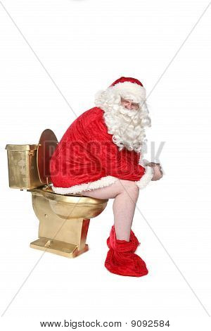 Man In Santa Costume Sitting On A Golden Toilet