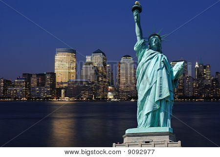 Statue Of Liberty And New York City Skyline
