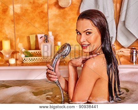 Young woman looking at camera take bubble  bath.