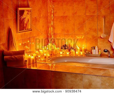 Home bathroom interior with bubble bath. Burning candels.