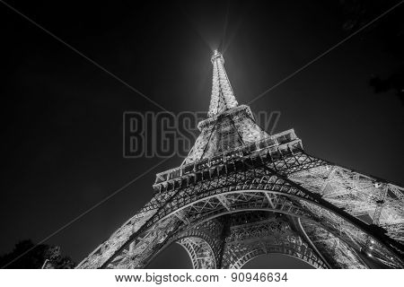 PARIS - SEP 08: Eiffel tower at night on September 08, 2014 in Paris, France. The Eiffel tower is the most visited monument of France.