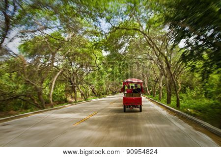 Tourists travelling in rickshaw enjoying beautiful views of Manabi, Ecuador