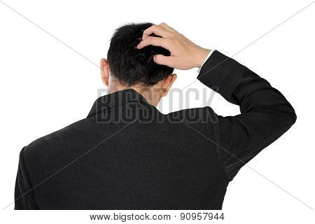 A Man In Suit Scratching His Head In Confusion, Isolated On White