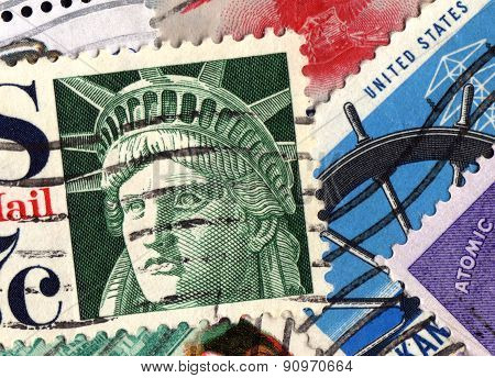Assorted cancelled USA postage stamp collection background poster