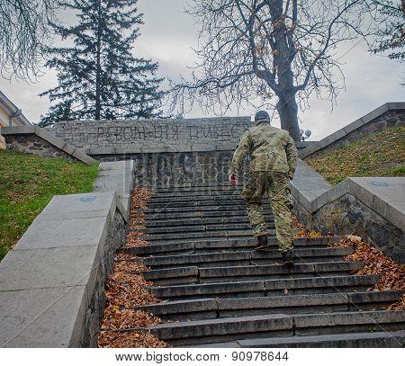 Kiev, Ukraine - October, 23, 2014: Fighter Defense Maidan On The Street Institutska. Writing On The