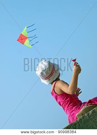 Little Child Playing With A Kite