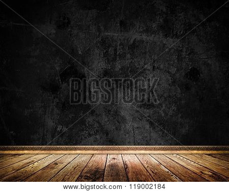 Black Grunge Wall And Old Wooden Floor.