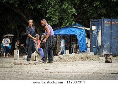 Workmen Making Conrete Manually