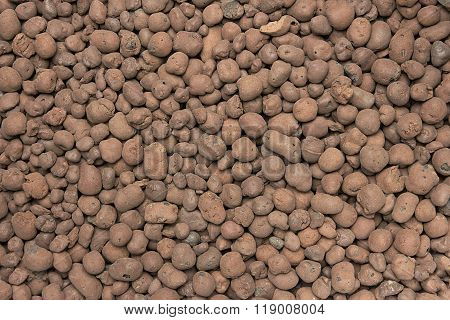 Heat expanded clay pebbles used as a growing media in hydroponics. Background close up of pellets.