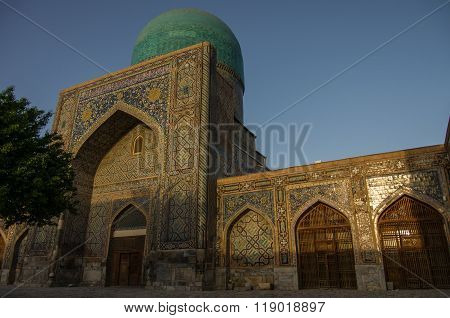 Morning Sun In Wall Of Madrasas With Traditional Mosaic Ornament . Samarkand, Uzbekistan