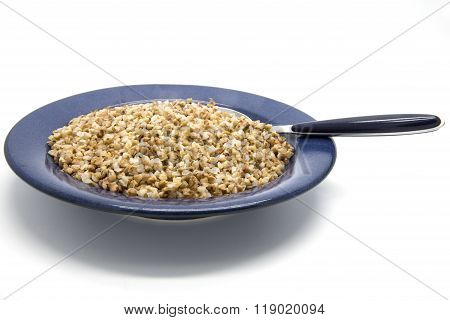 Buckwheat porridge in plate on white isolated background