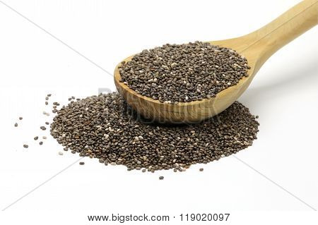 Chia seeds in a wooden spoon on white isolated background