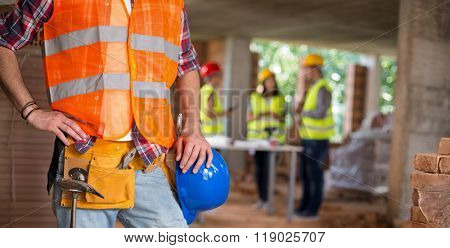 Close up of worker posing with working belt and tools