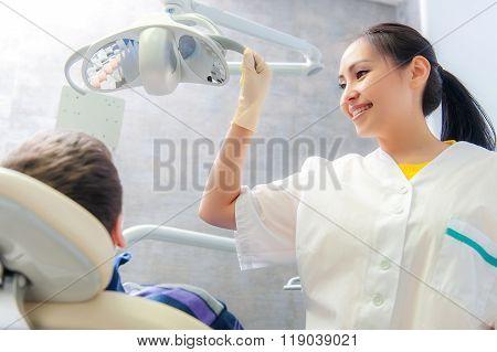 Portrait of a friendly dentist in dental clinic