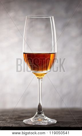 Glass of amontilliado sherry-jerez wine on wooden plank