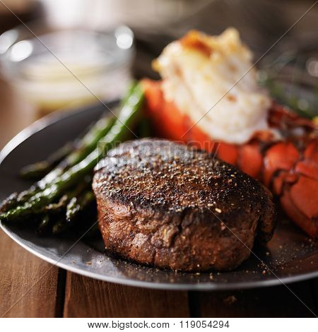lobster tail and filet mignon dinner with asparagus