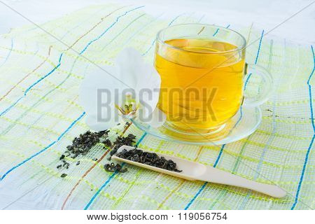 Cup Of Tea On Green Napkin