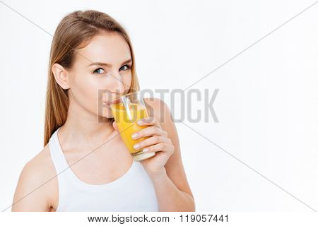 Charming woman drinking fresh juice isolated on a white background