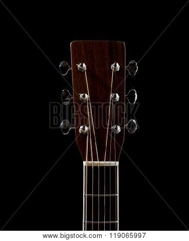 The Neck And Head Of An Acoustic Flat Top Guitar