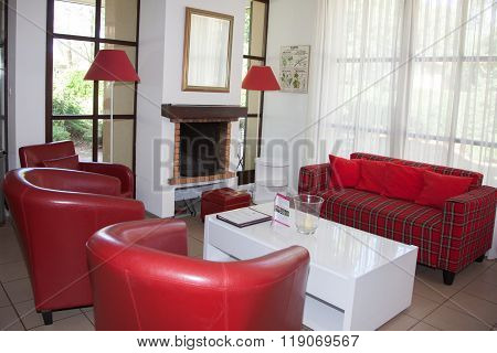 Classic Interiorof A Linving Room With A Red Sofa.