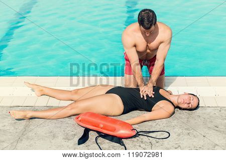 Lifeguard Doing Resuscitation Procedure