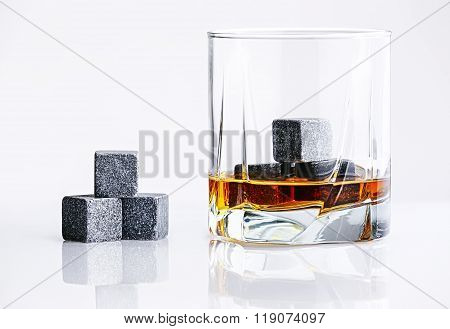 Close up view of whisky stones in the glass