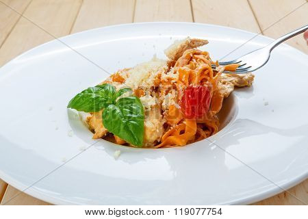 Eating Traditional Italian Pasta  With Fork