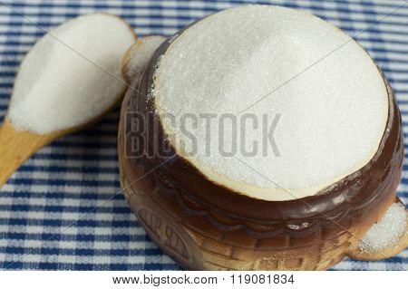 White sugar in a pot.