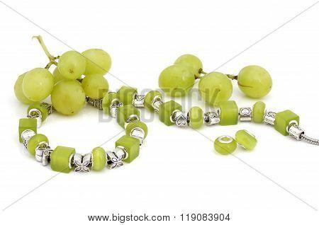 Green pandora bracelet and grapes