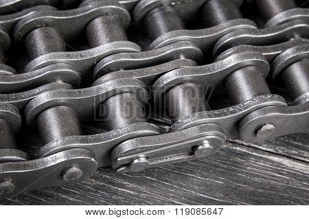 industrial roller chain on dark background